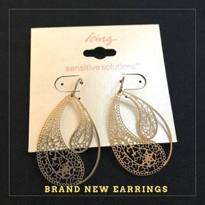 Brand new, never worn Icing brand silver earrings!